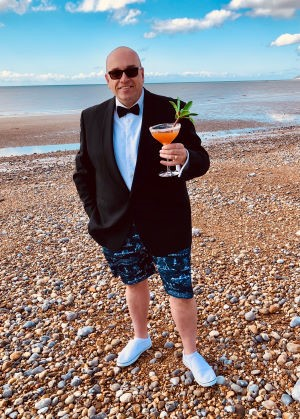Glenn Blackman celebrating the 2021 BMF Awards with a cocktail
